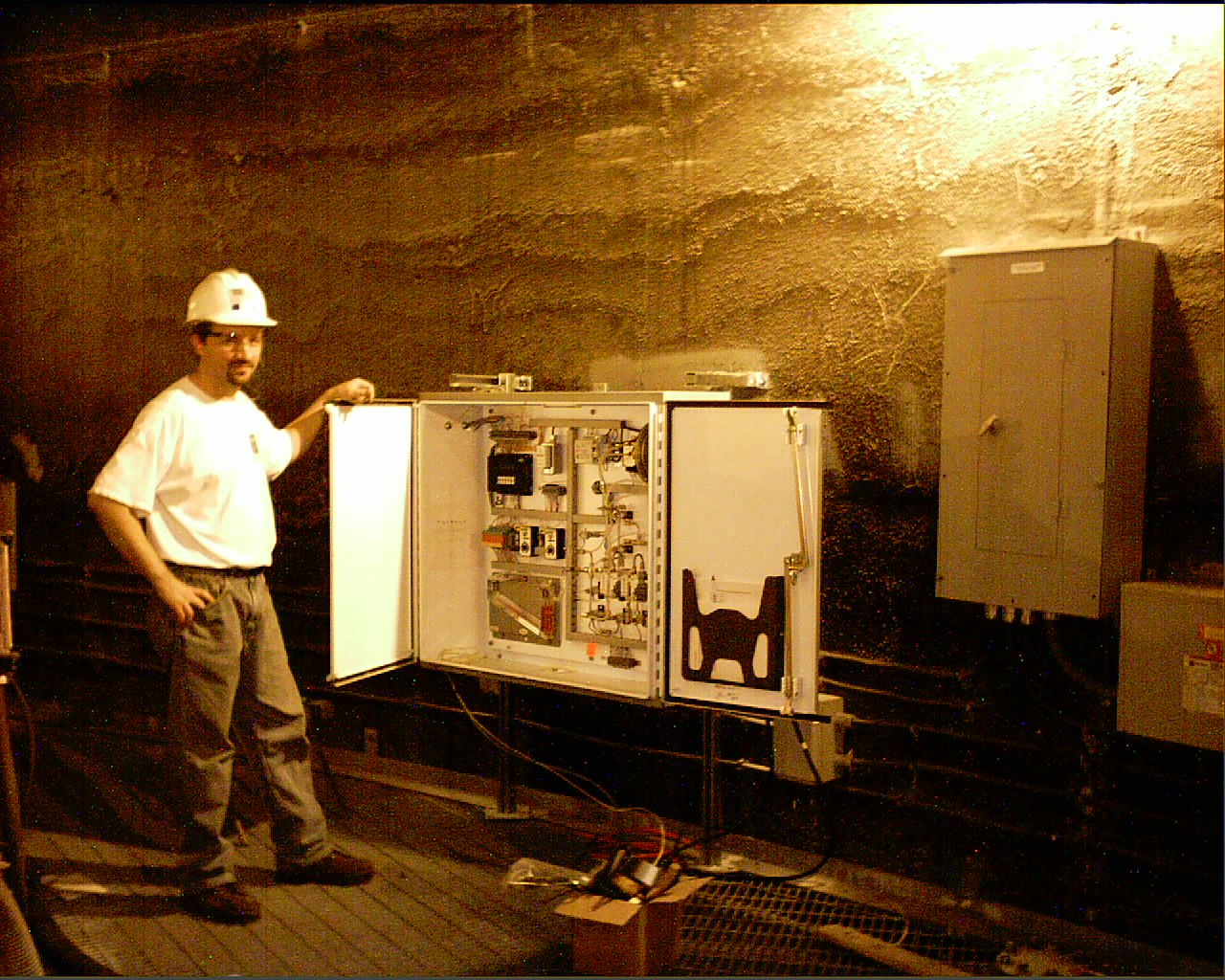 Worker standing by CEMflow box
